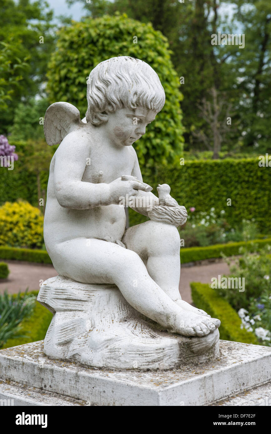 Amor statue in the Russian garden of Schloss Belvedere Palace, UNESCO World Cultural Heritage Site, Weimar, Thuringia, Germany - Stock Image