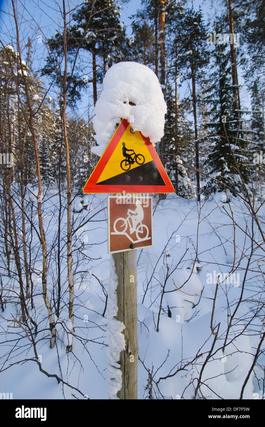 Trail sign indicator in the boreal forest for biking tours in summer, Oulanka area, Finland - Stock Image