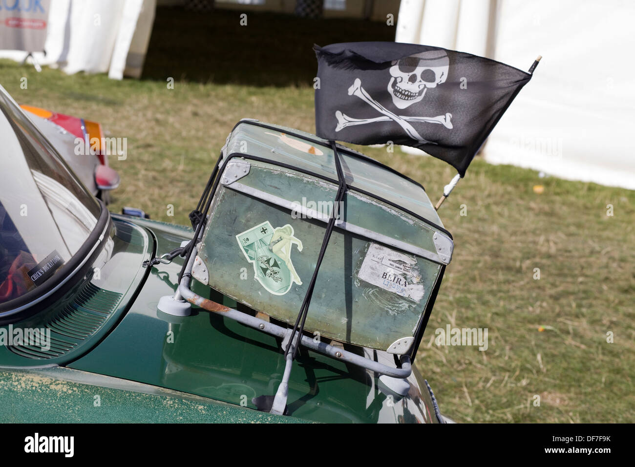 Old Retro Trunk with a Jolly Rodger Flag attached to a boot of a Volkswagen Car - Stock Image