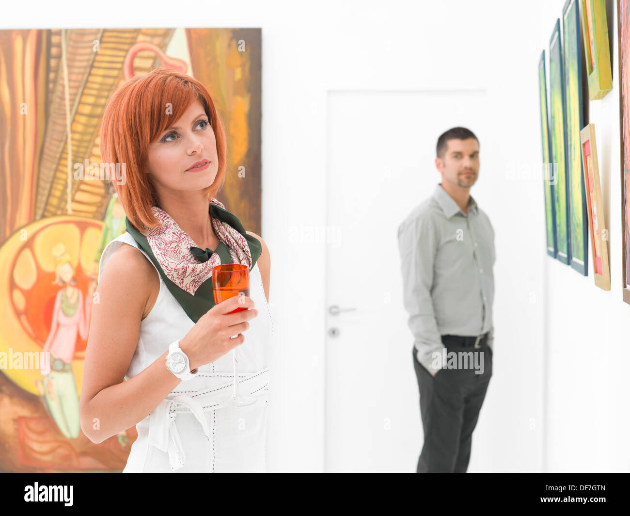 woman admiring painting in gallery stock photos & woman admiring