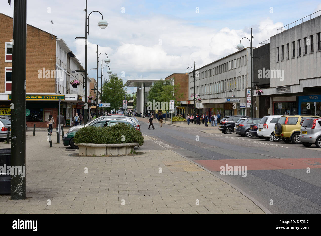 Modern shopping mall in Crawley Town Centre. West Sussex. England. With people and parked cars. - Stock Image