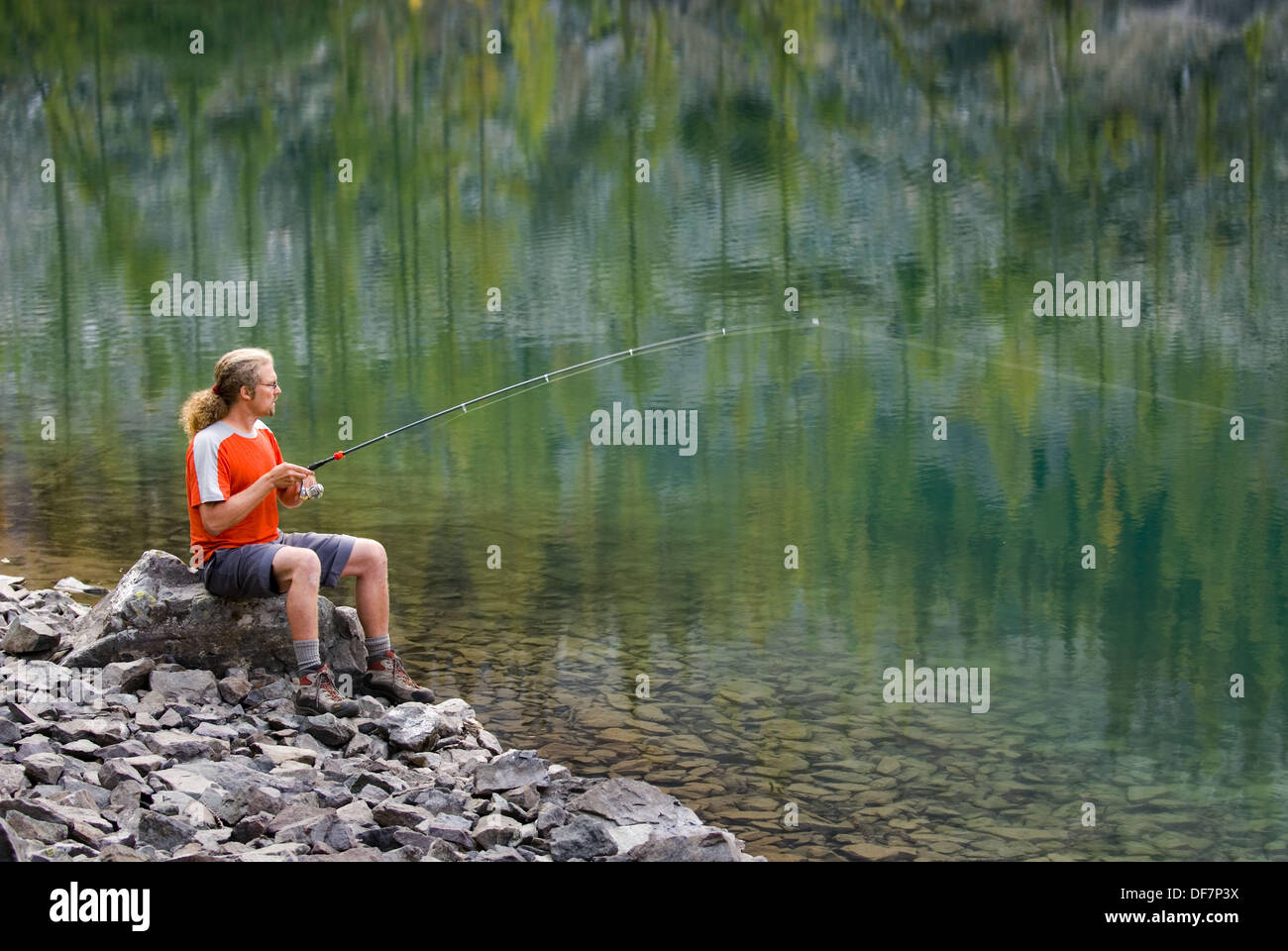 Fisherman trying his luck at Copper Glance Lake, Okanogan National Forest Wasington USA - Stock Image