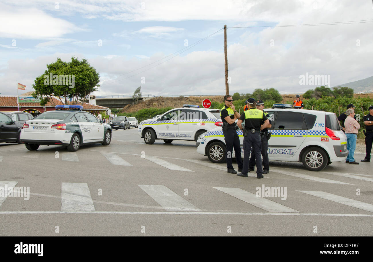 Civil Guards and local police blocking traffic on side of road in Southern Spain. - Stock Image