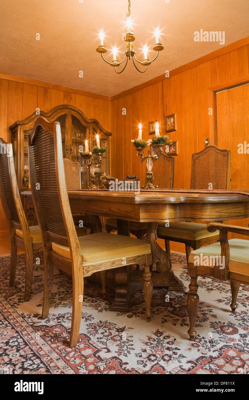 Table and chairs in the dining room of an Old circa 1834 Residential fieldstone and wooden siding home, Quebec, Canada, This - Stock Image