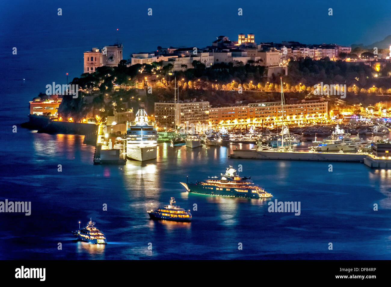 Europe, France, Principality of Monaco, Monte Carlo. The Rock of Monaco at night. - Stock Image