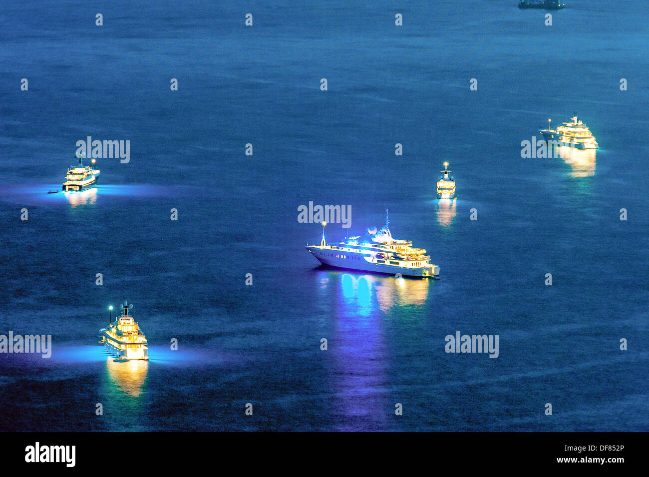 Europe, France, Principality of Monaco, Monte Carlo. Cruise ships off Monaco at night. - Stock Image