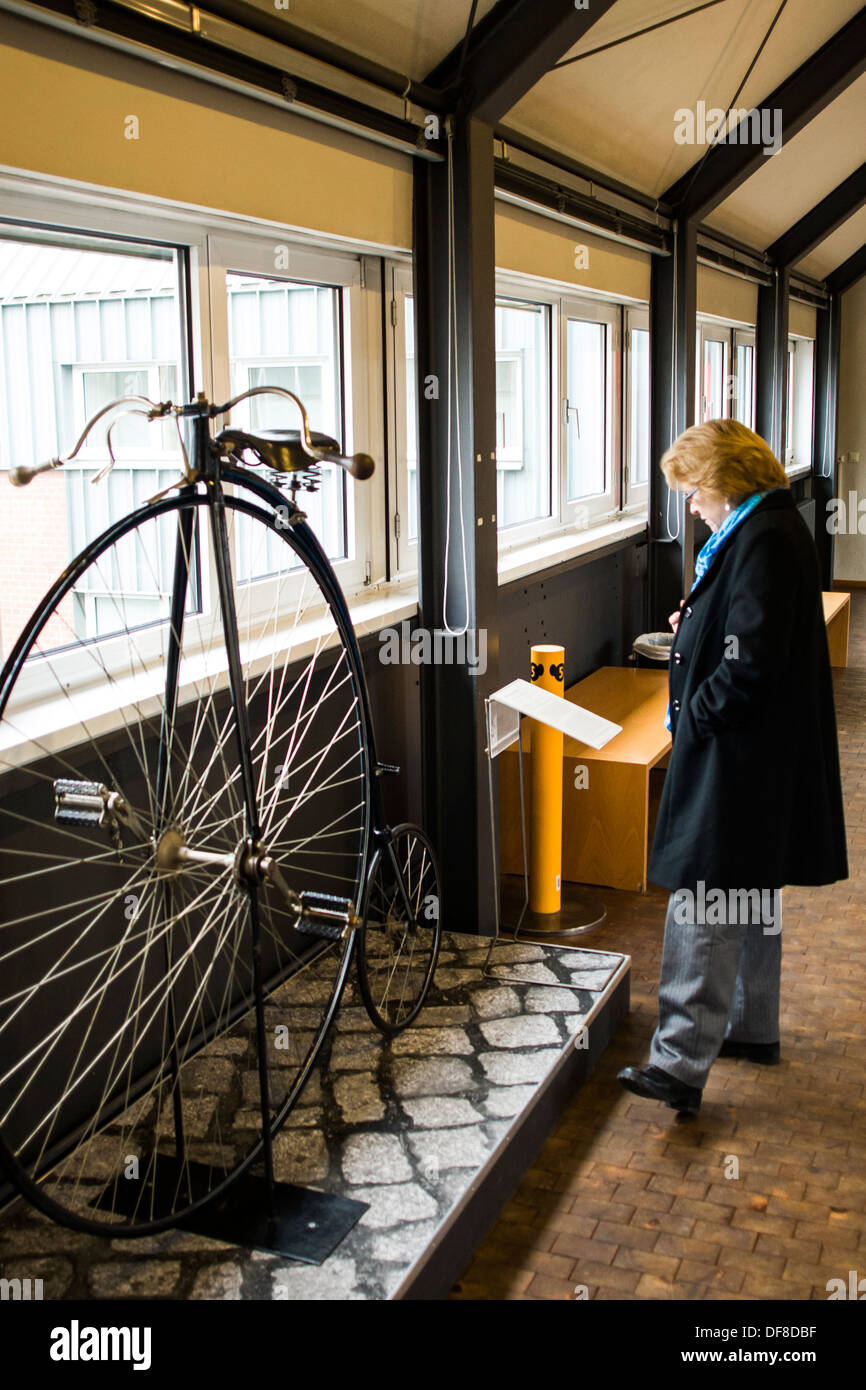Visitor looking at an early bicycle at Deutsches Technikmuseum (German Technology Museum). Berlin, Germany. - Stock Image