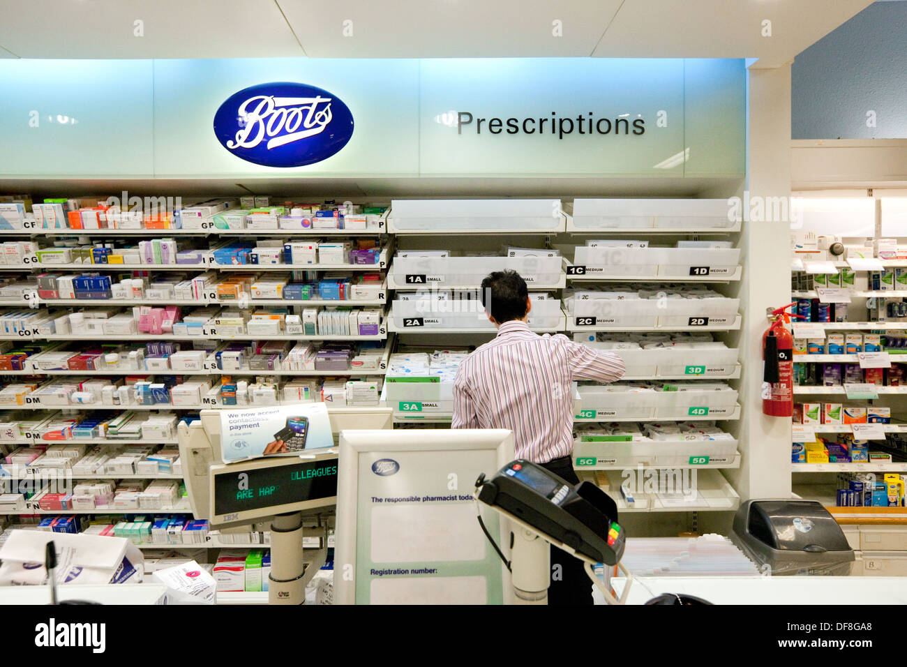 Boots the Chemist, the pharmacist working in the pharmacy, UK - Stock Image