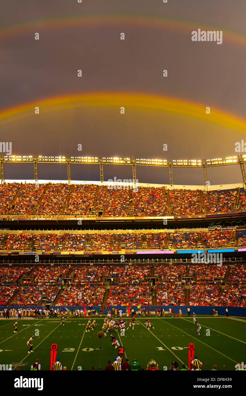 A rainbow over the stadium, Denver Broncos vs. Pittsburgh Steelers NFL football game, Invesco Field at Mile High Stock Photo