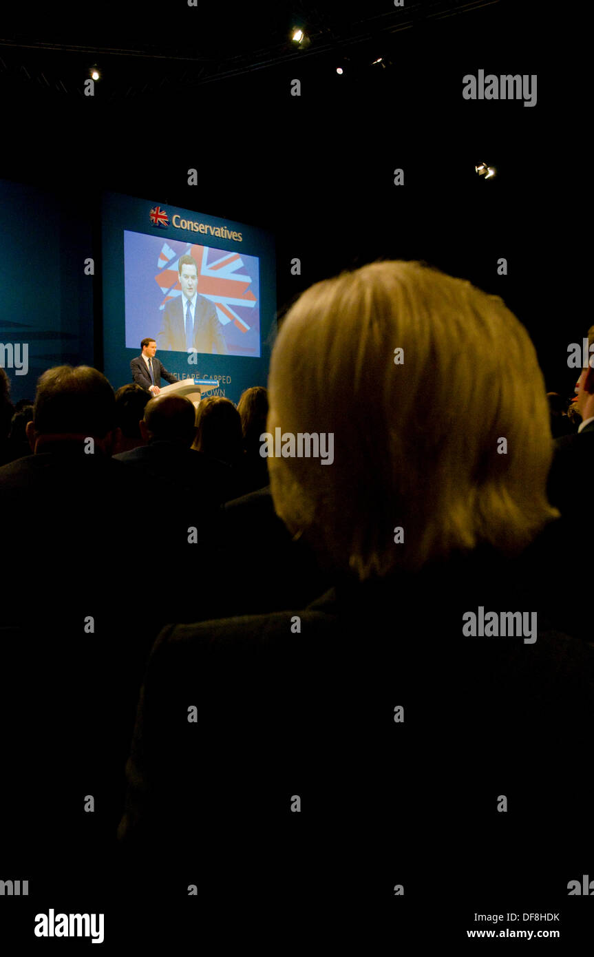 Manchester, UK. 30th Sep, 2013. A delegate listens to Chancellor George Osborne deliver his keynote speech on the economy Credit:  Paul Swinney/Alamy Live News - Stock Image