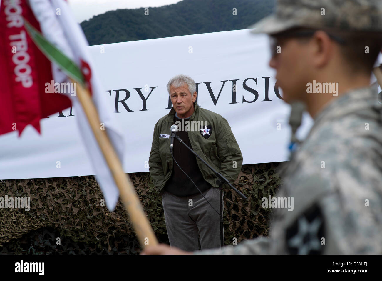 US Secretary of Defense Chuck Hagel talks with troops from the US Army 2nd Infantry Division September 30, 2013 at the demilitarized zone Panmunjom, Republic of Korea. - Stock Image