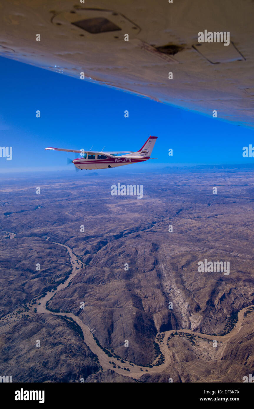 Two Desert Air Cessna 210´s fly above the Namib Desert, Namibia - Stock Image