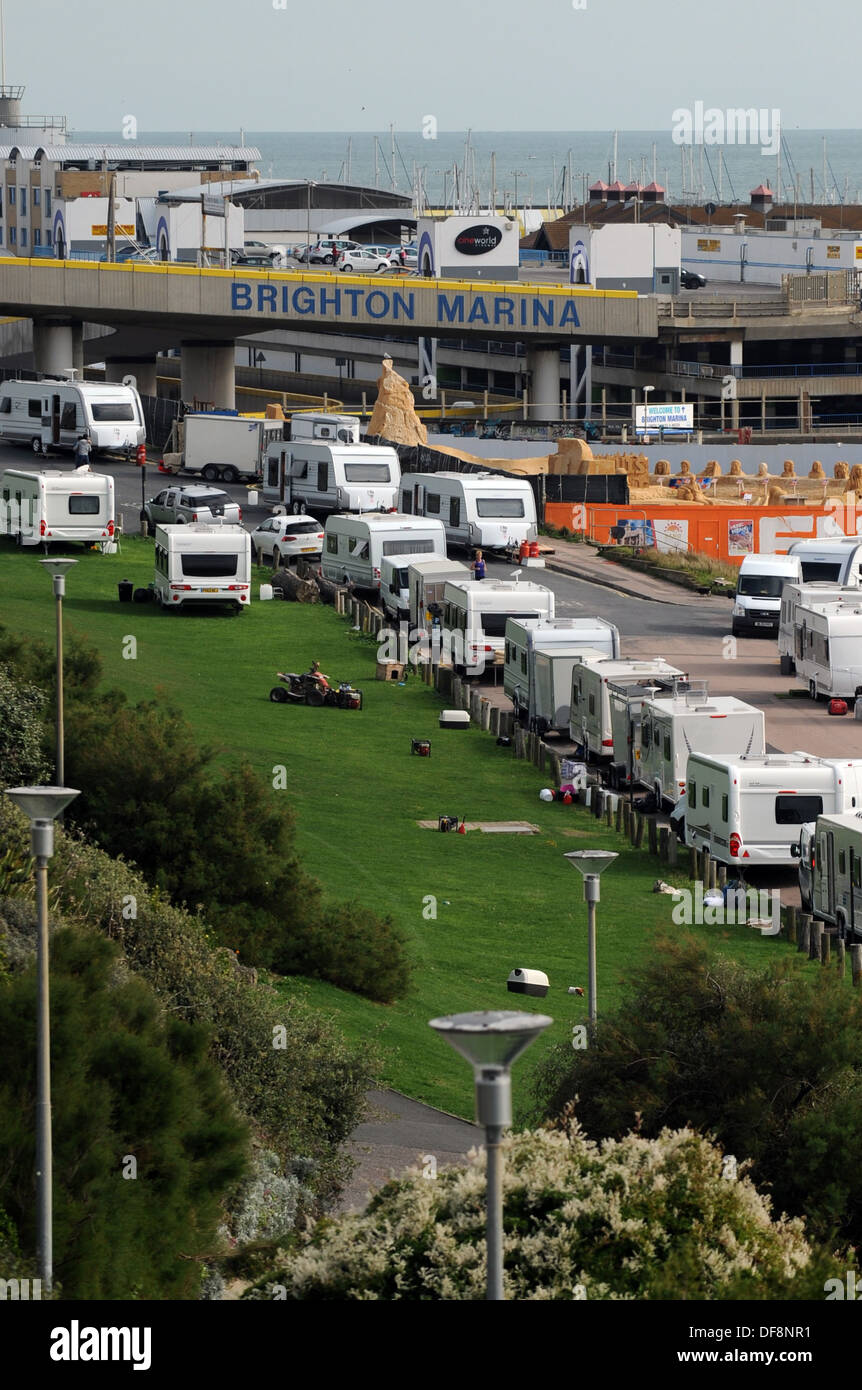 Illegally parked travellers caravans at Black Rock beside Brighton Marina UK - Stock Image