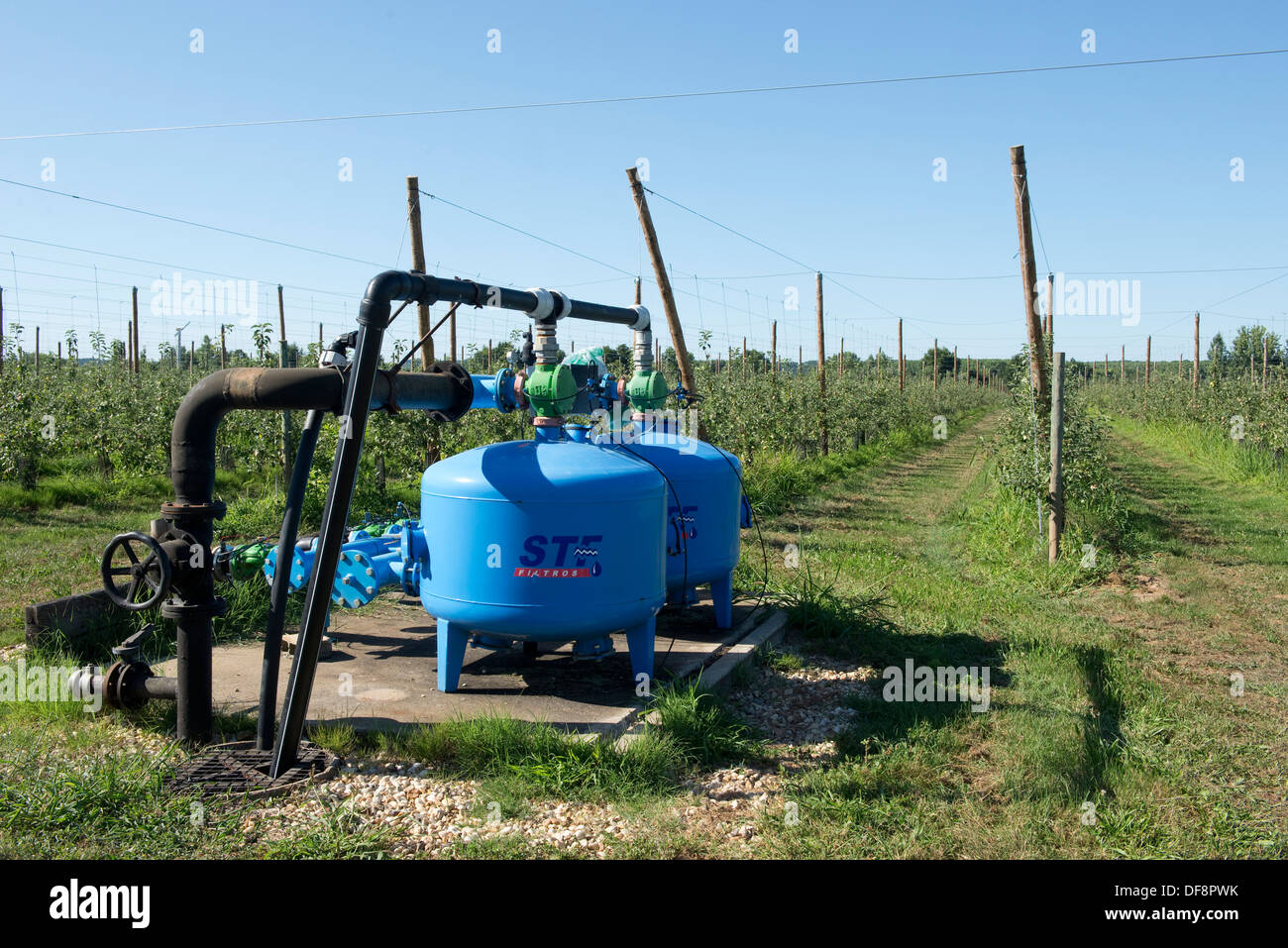 Irrigation and fertigation pump for cordon apple trees at Sainte-Foy-la-Grande, France - Stock Image