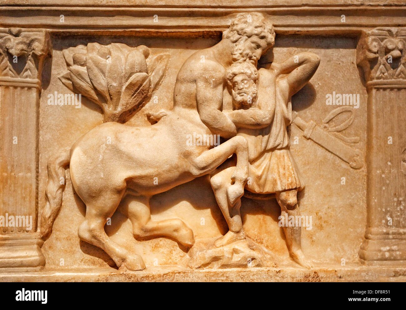 A Centaur wrestles with a bearded man on a marble ossuary in the form of a sarcophagus (150-200 A.D.) in National Museum, Greece - Stock Image