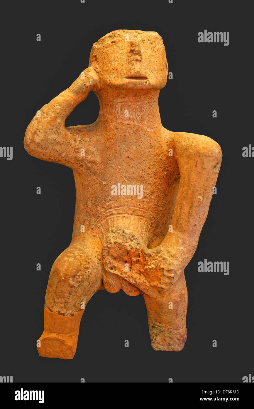 The ''Thinker'' is Large compact figure of a seated man (4500-3300 B.C.) in National Museum, Greece - Stock Image