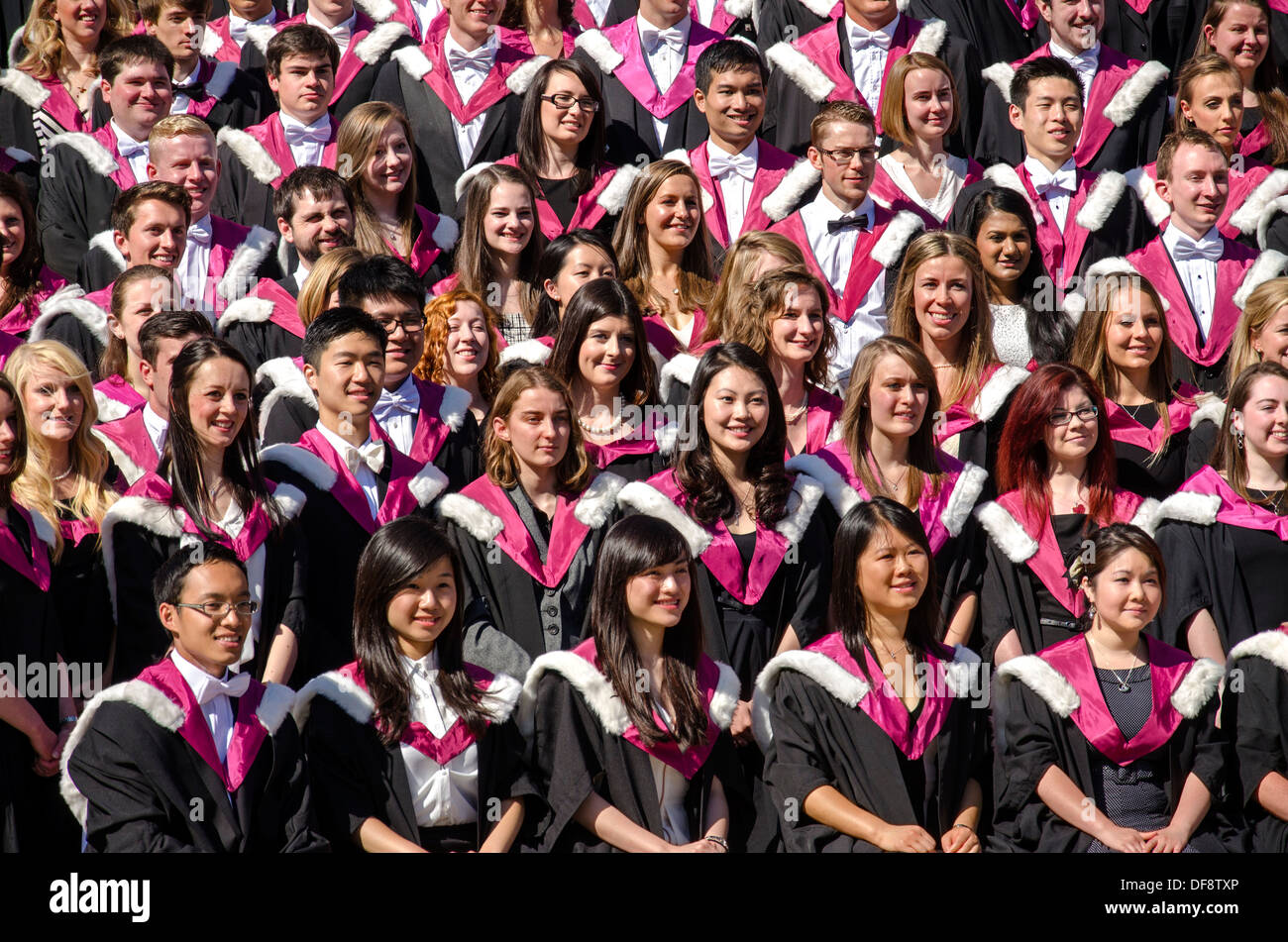 Happy students posing for a group photograph after graduating from Edinburgh University. - Stock Image