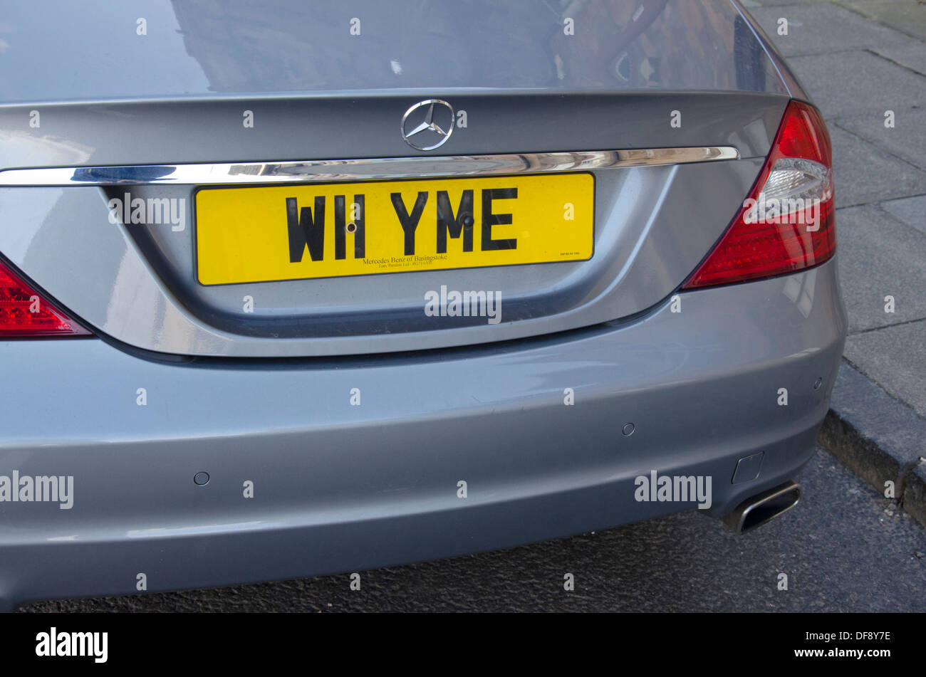 Personalised car license plate spelling out the question, 'Why me'. - Stock Image