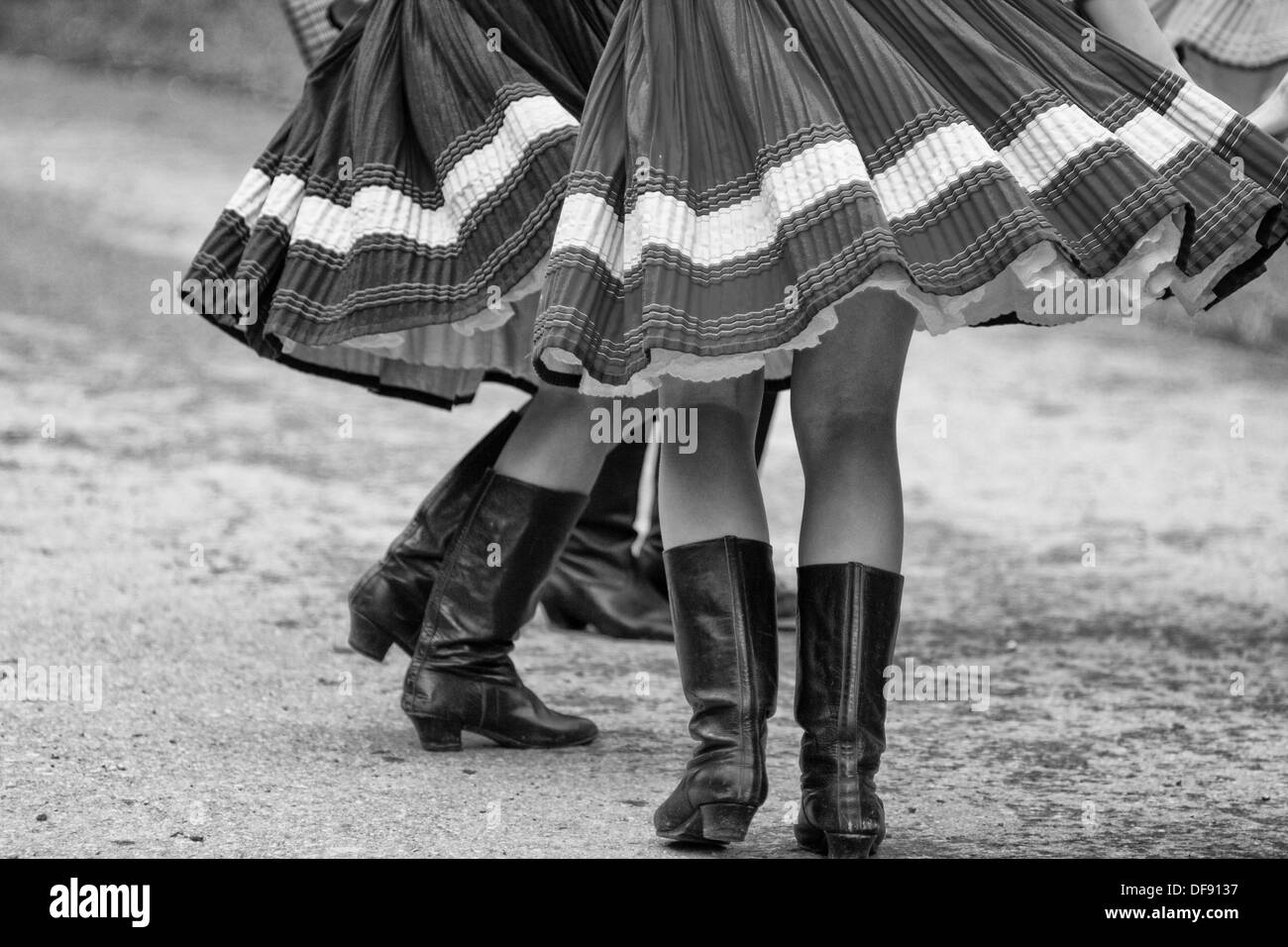 Skirts and high boot in dance - Stock Image