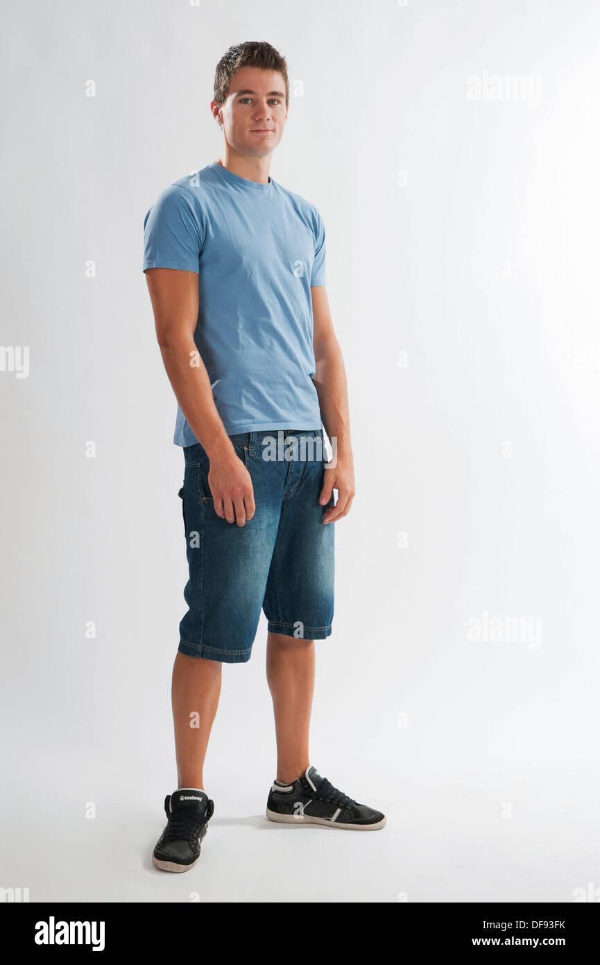fullbody photograph of a teenage boy standing stock photo