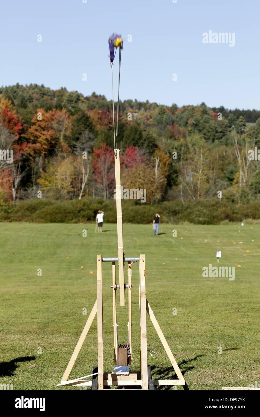 Pumpkin launches from Trebuchet at Pumpkin Chuckin Festival in Stowe, Vermont - Stock Image