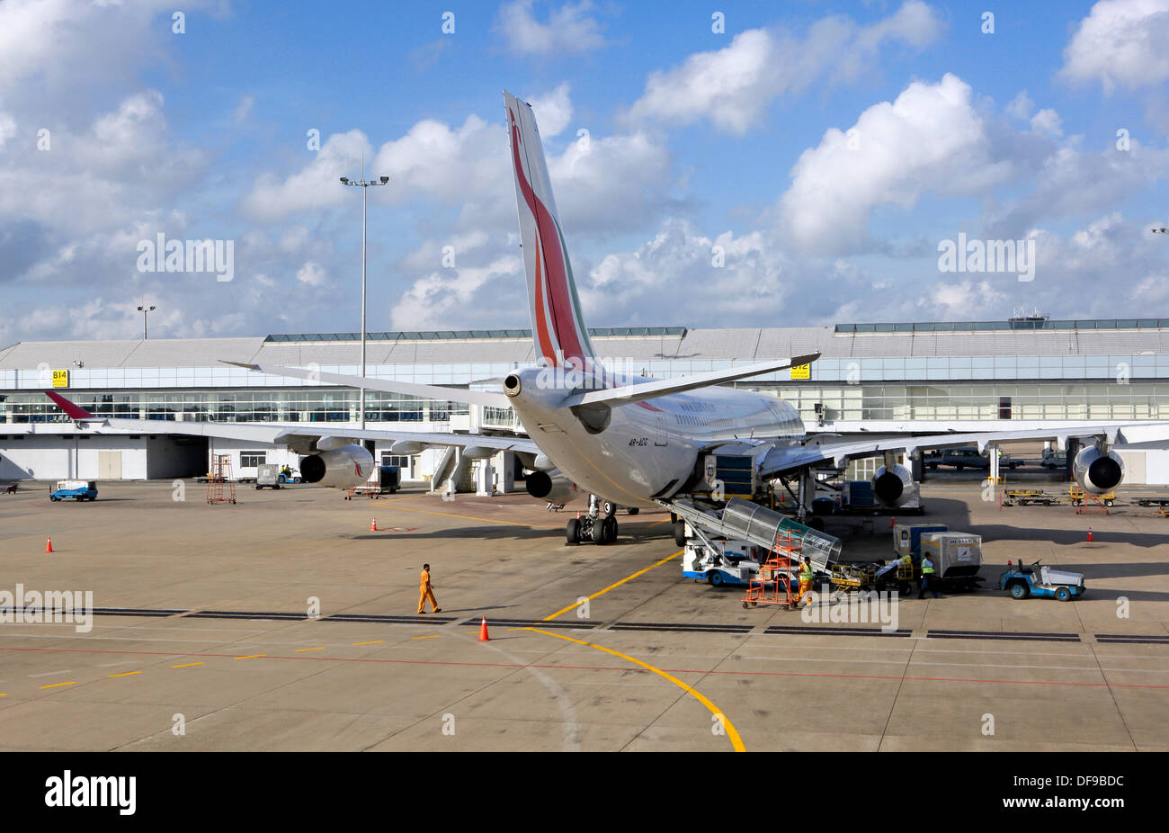Jet airliner on tarmac at Phuket airport - Stock Image