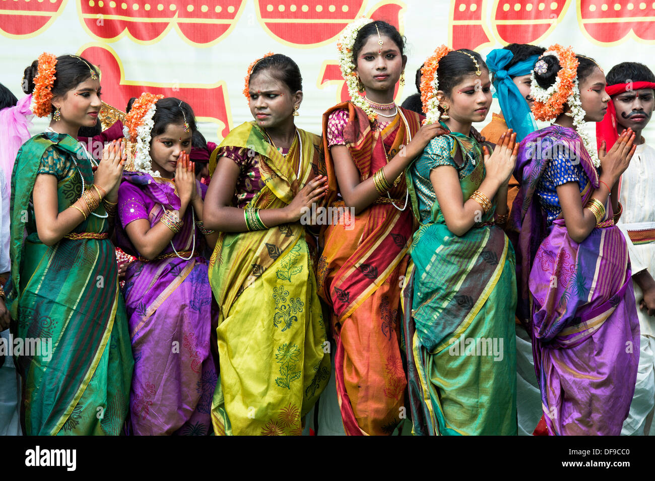 Indian girls dressed in traditional colourful silk saris at a protest rally. Puttaparthi, Andhra Pradesh, India - Stock Image