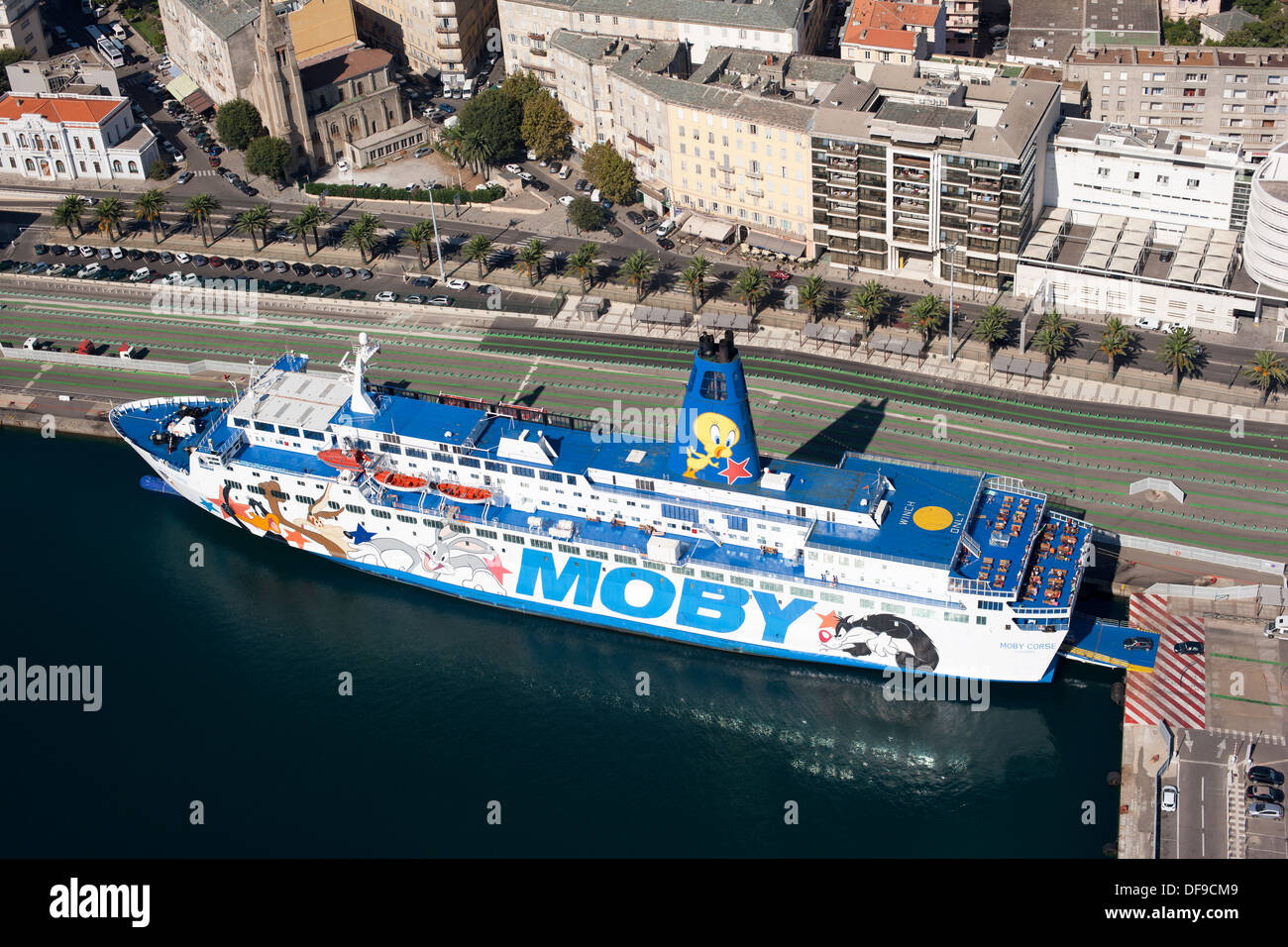 FERRYBOAT BEING LOADED (aerial view). Saint-Nicolas Port, Bastia, Corsica, France. - Stock Image