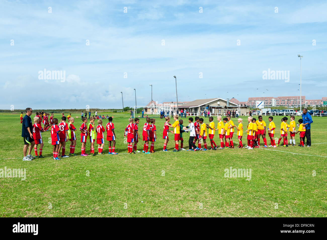 Junior football teams greeting each other before the match, Cape Town, South Africa - Stock Image