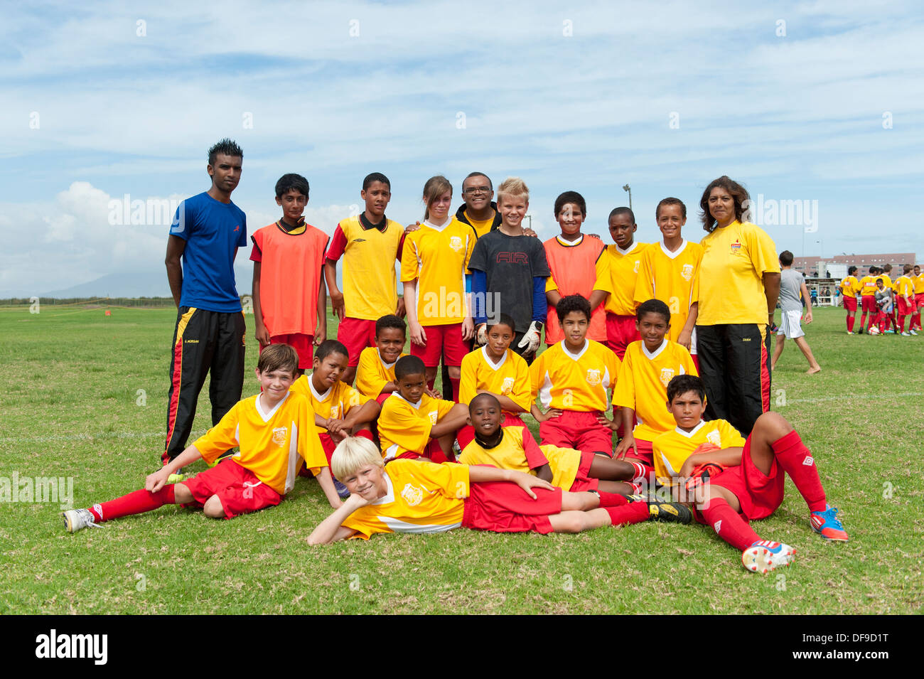 Junior football players with coach, team photo, Cape Town, South Africa - Stock Image