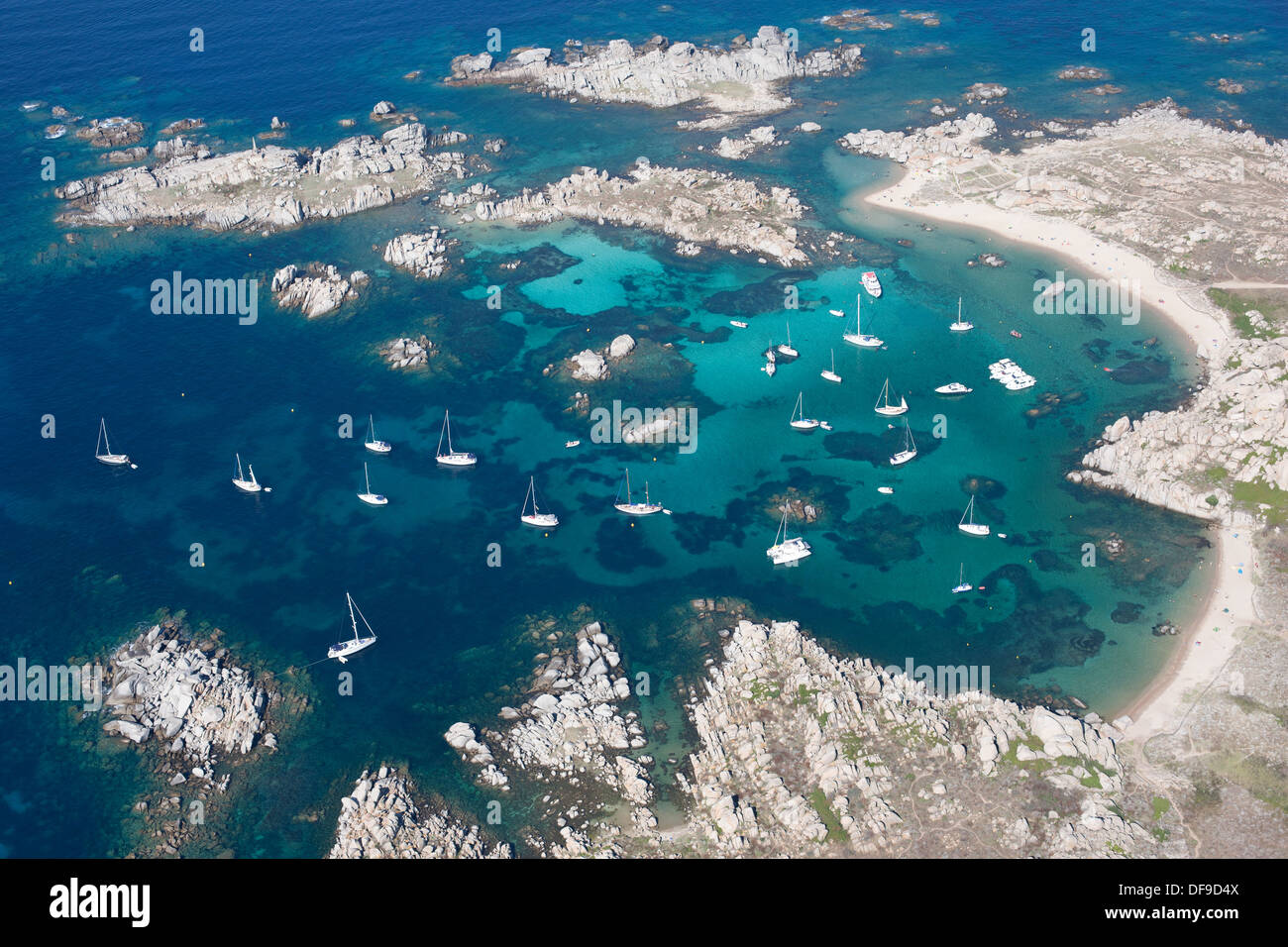 LAVEZZI ISLANDS (aerial view). Azure bay with yachts. Anchorage of Cala Lazarina, Corsica, France. - Stock Image