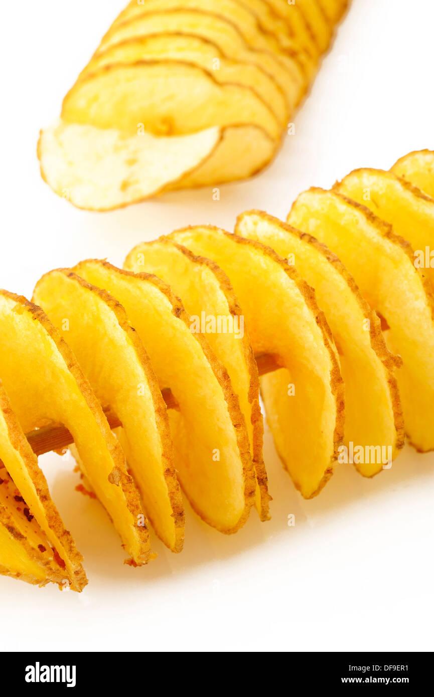 twist potato on white background - Stock Image