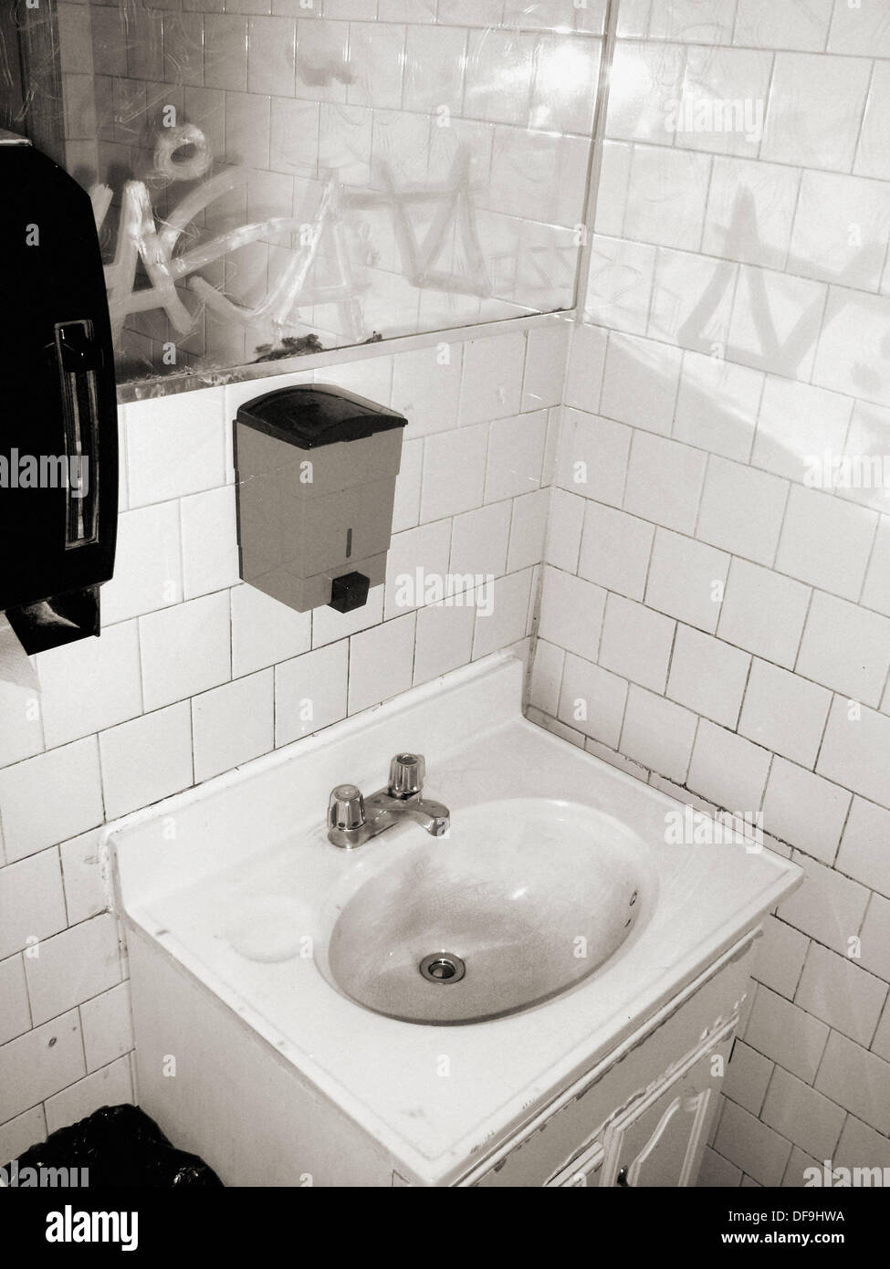 The sink of a public bathroom in an old diner in New York City Stock ...