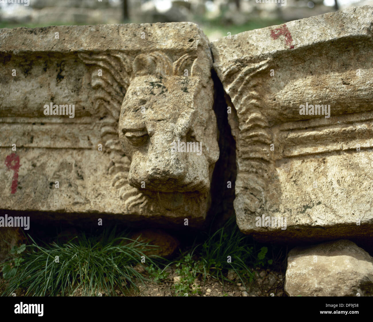 Basilica of Saint Simeon Stylites. 5th century. Sculptural detail depicting a head of a lion. Near Aleppo. Syria. - Stock Image