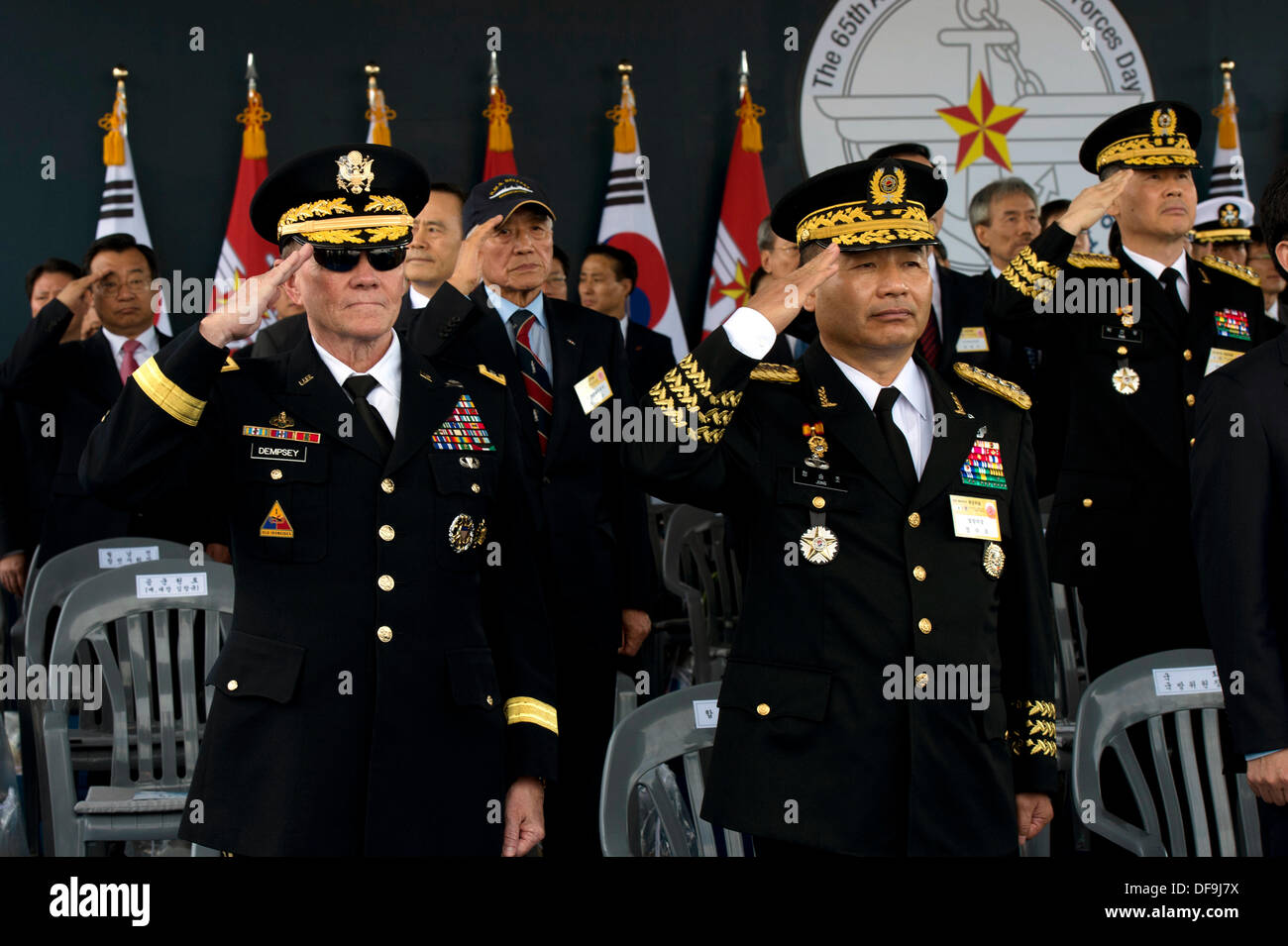 US Chairman of the Joint Chiefs General Martin Dempsey and South Korea General Jung Seung-jo salute during the ROK Armed Forces Parade October 1, 2013 in Seoul, Republic of Korea. The military parade commemorates the anniversary of the ROK-U.S. Alliance. - Stock Image