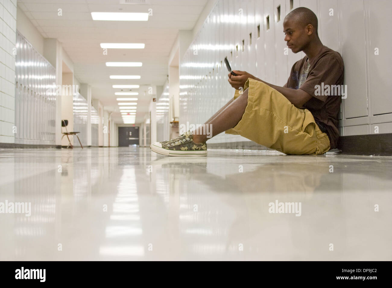 Brian Curtiss is a frequent text messenger. He´s taking classes this summer at Hazelwood East. - Stock Image