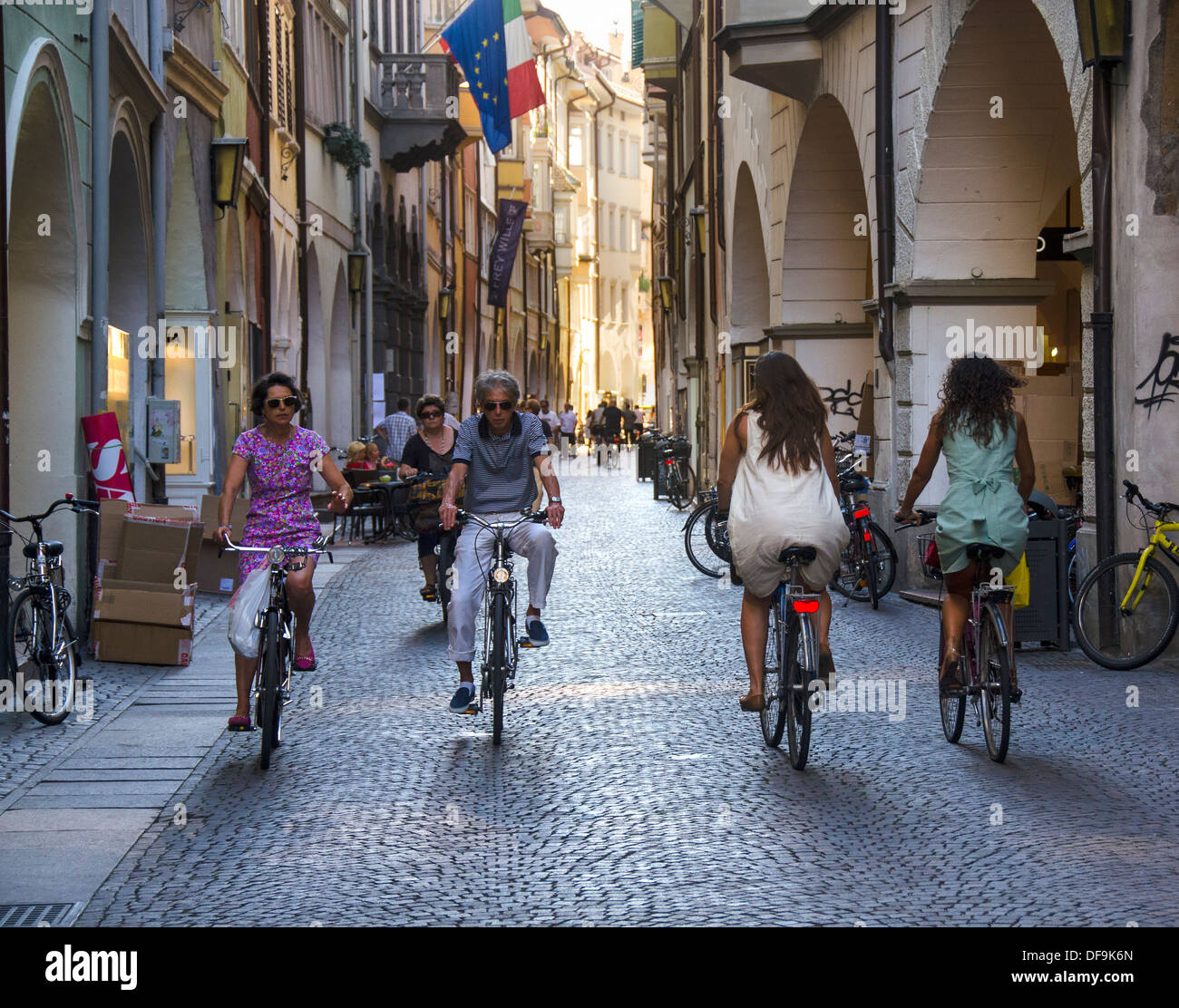 Bicyclists in historic city centre; old town; Bolzano; South Tyrol; Italy; Europe - Stock Image