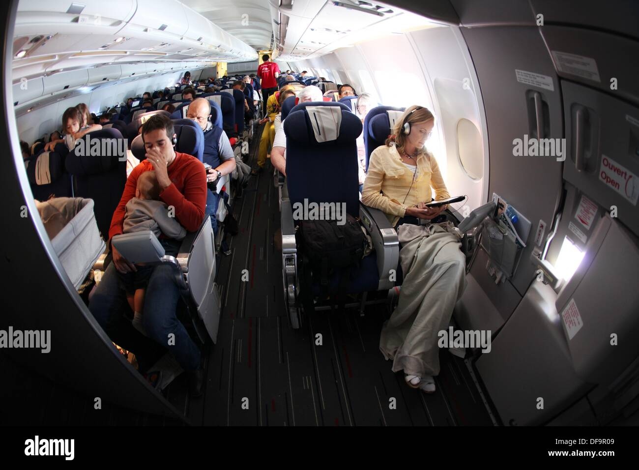 Passengers on an airplane - Stock Image