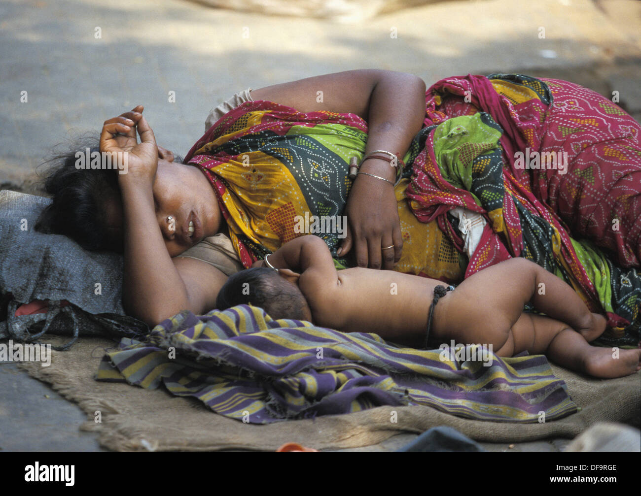 Mother and son sleeping in the streets of Calcutta, India Stock Photo