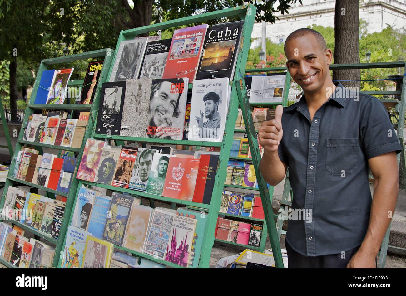 A book seller at his book racks in the Plaza De Armas. - Stock Image