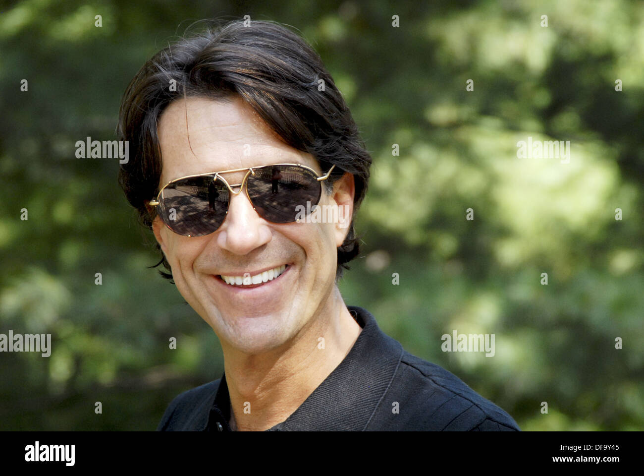 40-45 year old caucasian male, wearing sunglasses - Stock Image