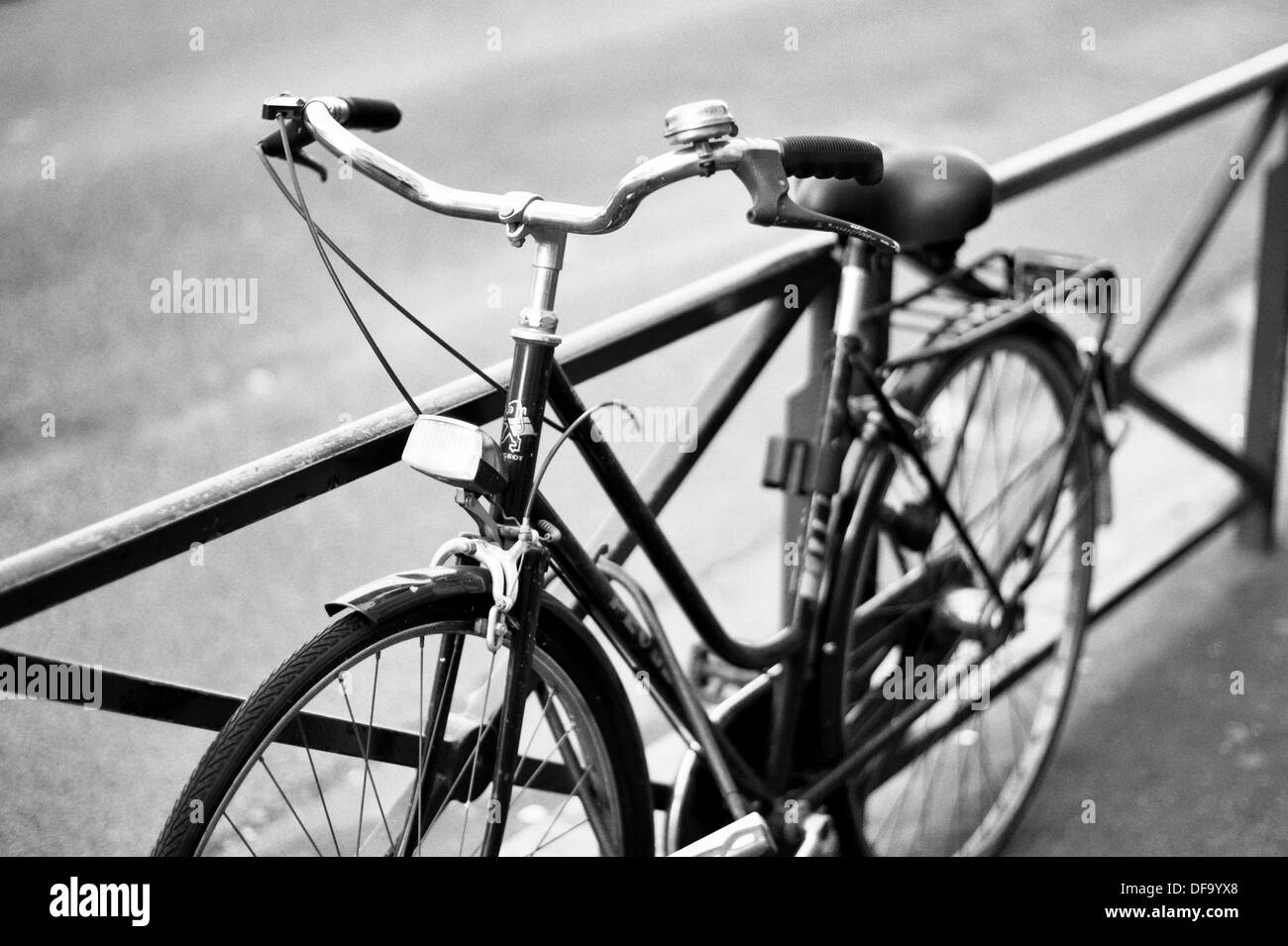 Old style bicycle locked to a railing in Paris France - Stock Image