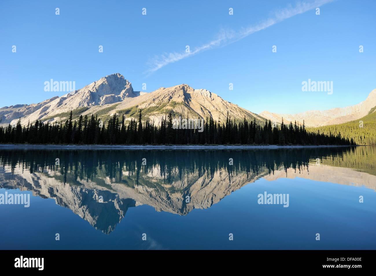 Reflexion on Maligne Lake  Jasper National Park, Rocky Mountains, Alberta, Canada - Stock Image
