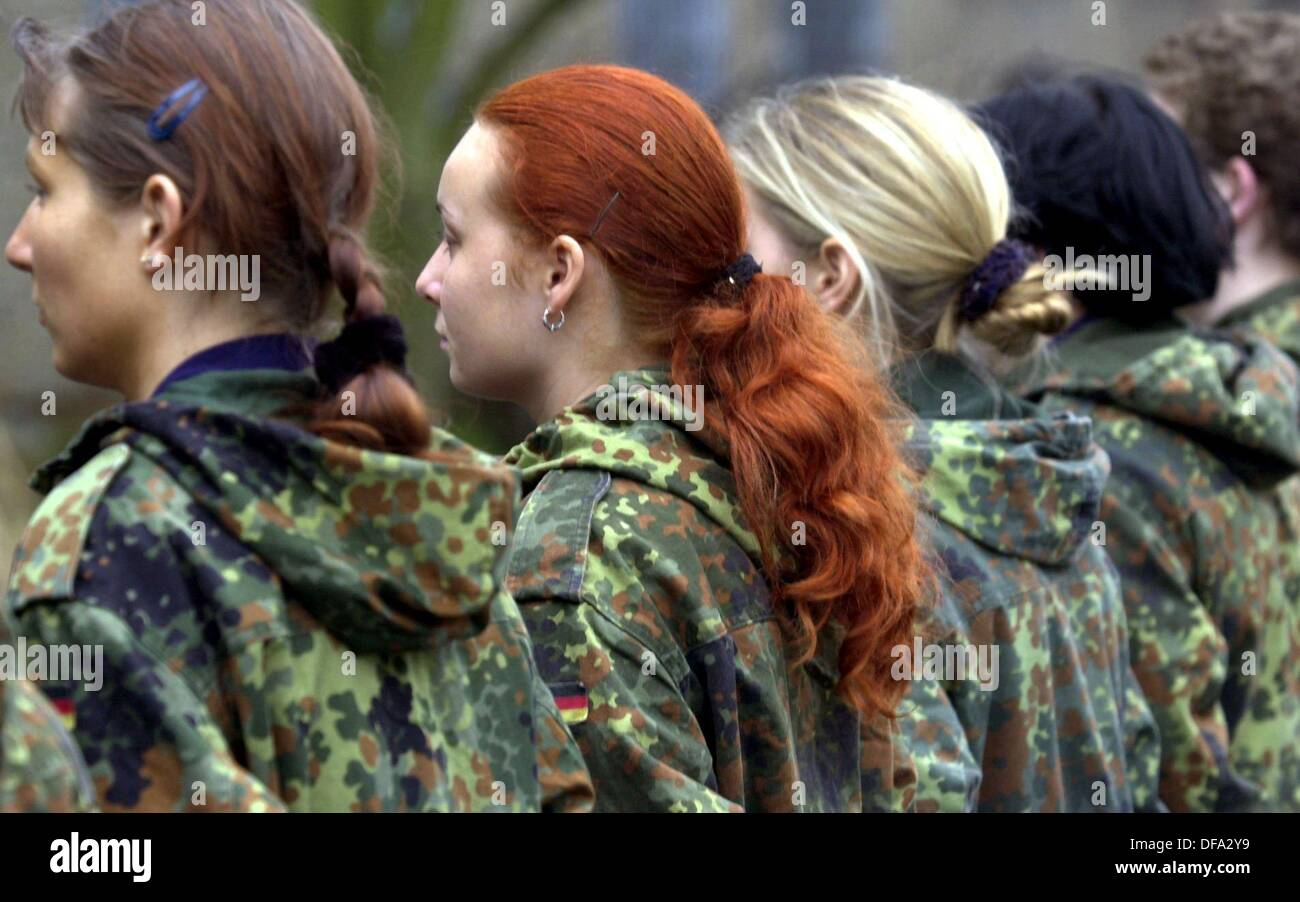 The first young female recruits enlist for military service together with their male comrades on the 3rd of January Stock Photo