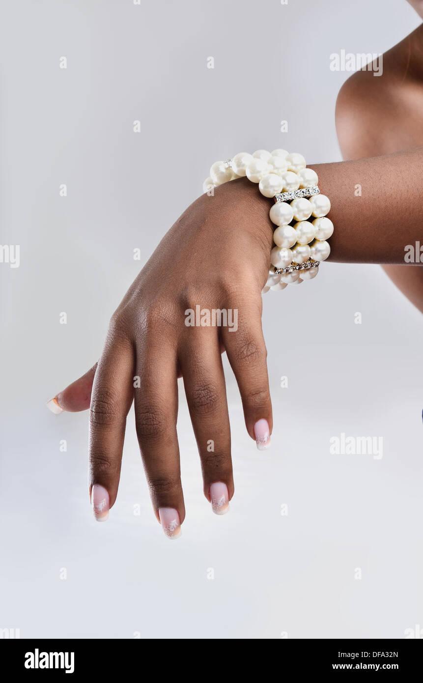 pearl bangle with metallic stripes - Stock Image