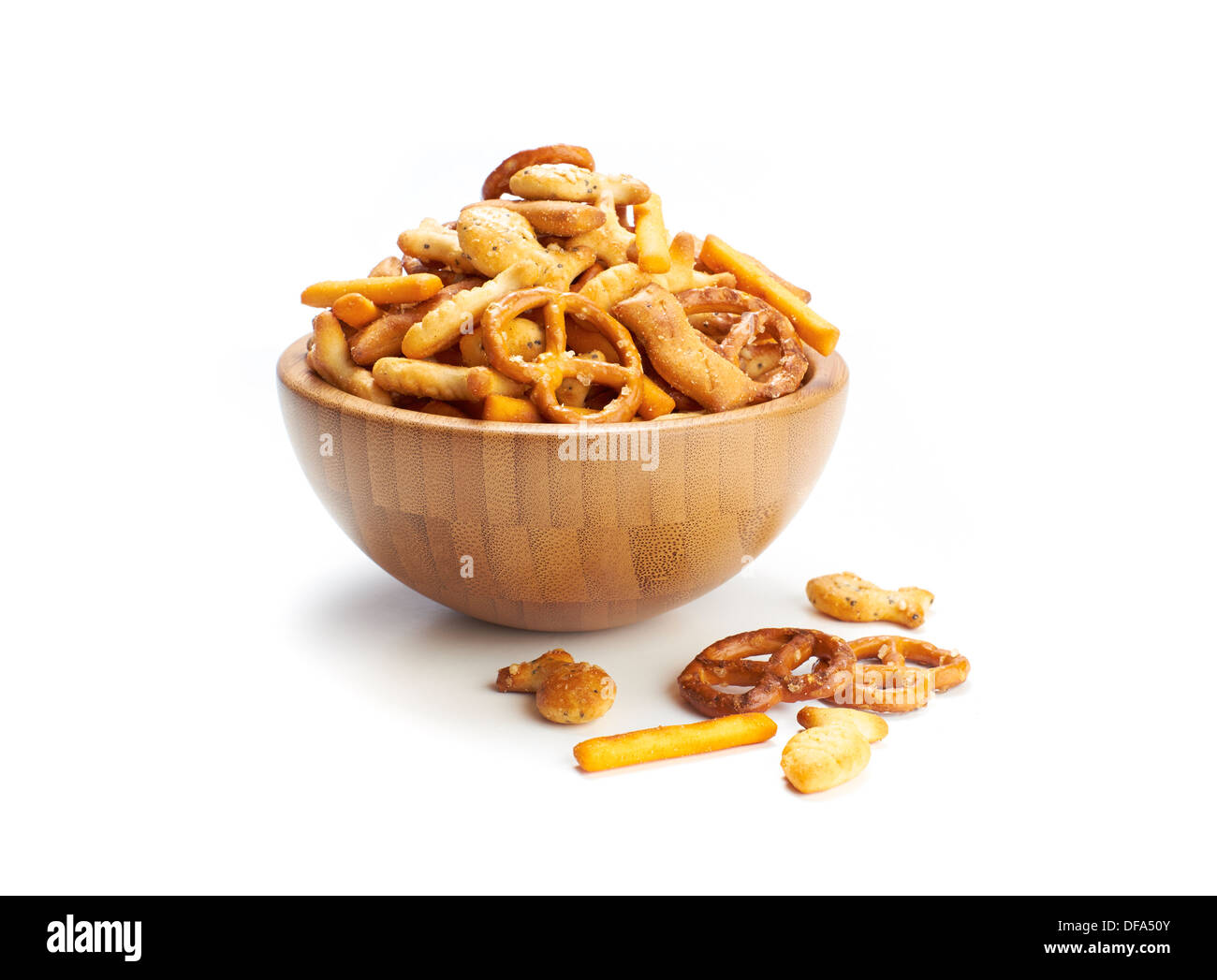 A pile of salted mixed party snacks background. - Stock Image
