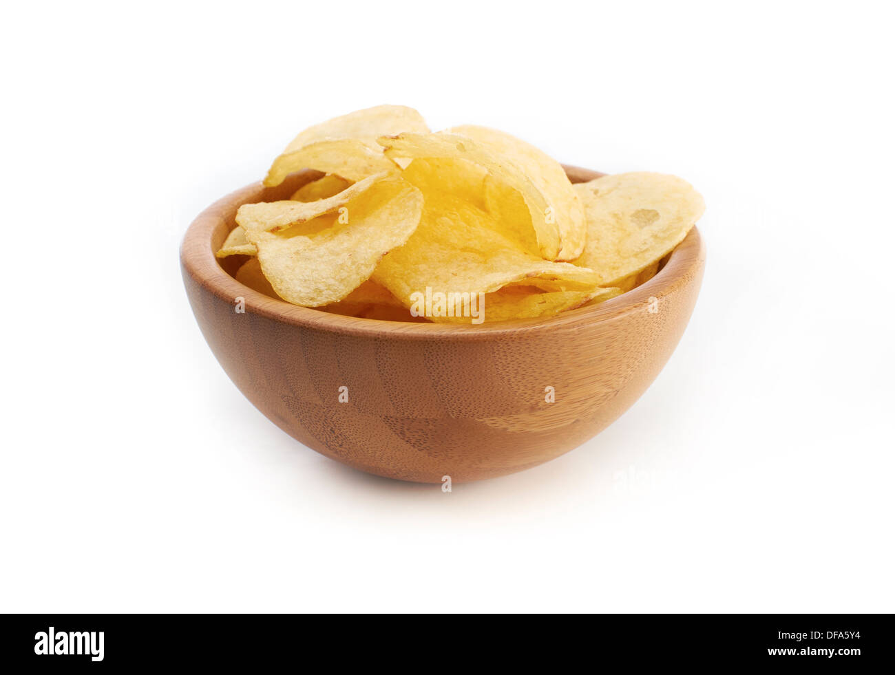 A bowl of salted crisps on a white background. - Stock Image