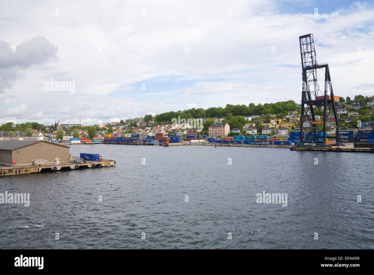 Moss Ostfold Norway Europe Containers piled on harbour front of coastal town on Oslofjord - Stock Image