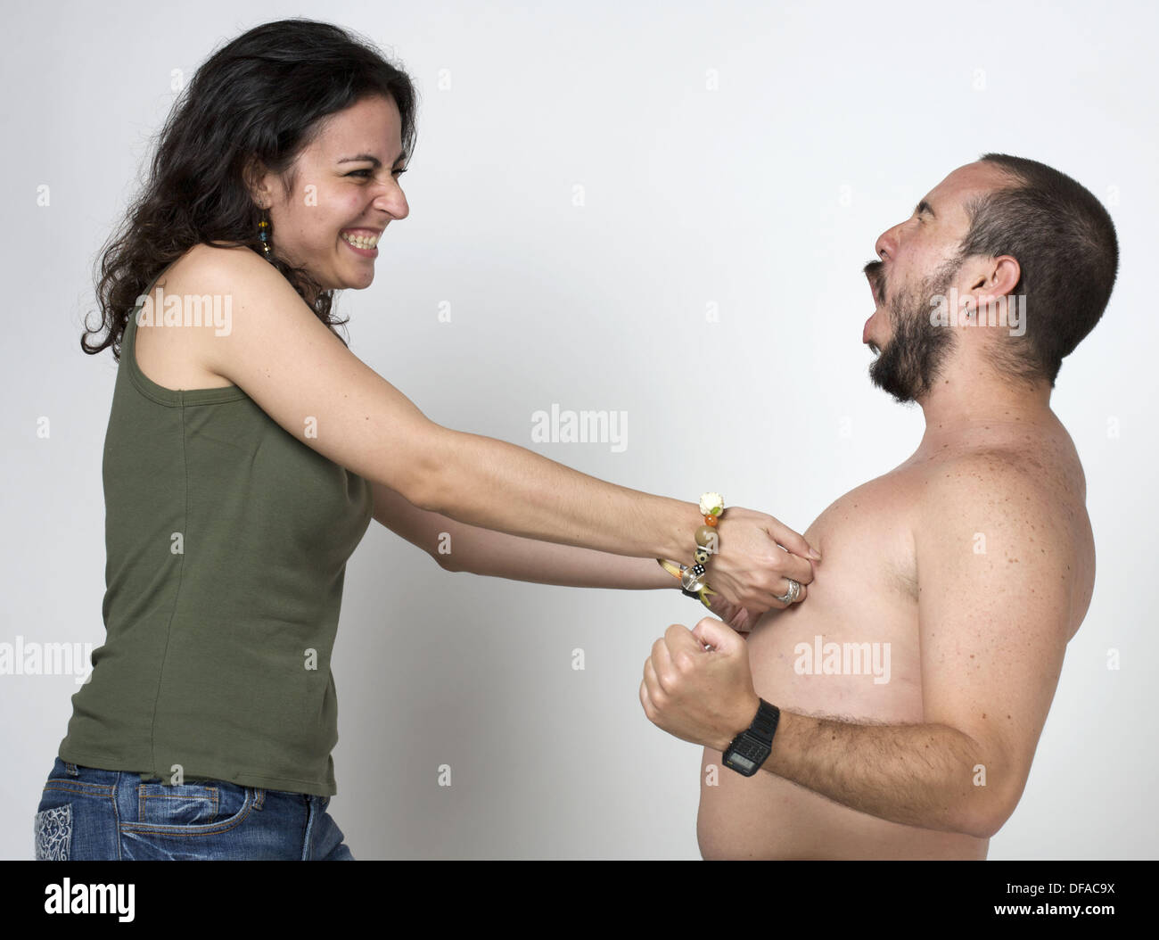 Young Newlywed Girl Pinching Her Husbands Nipples Stock Image