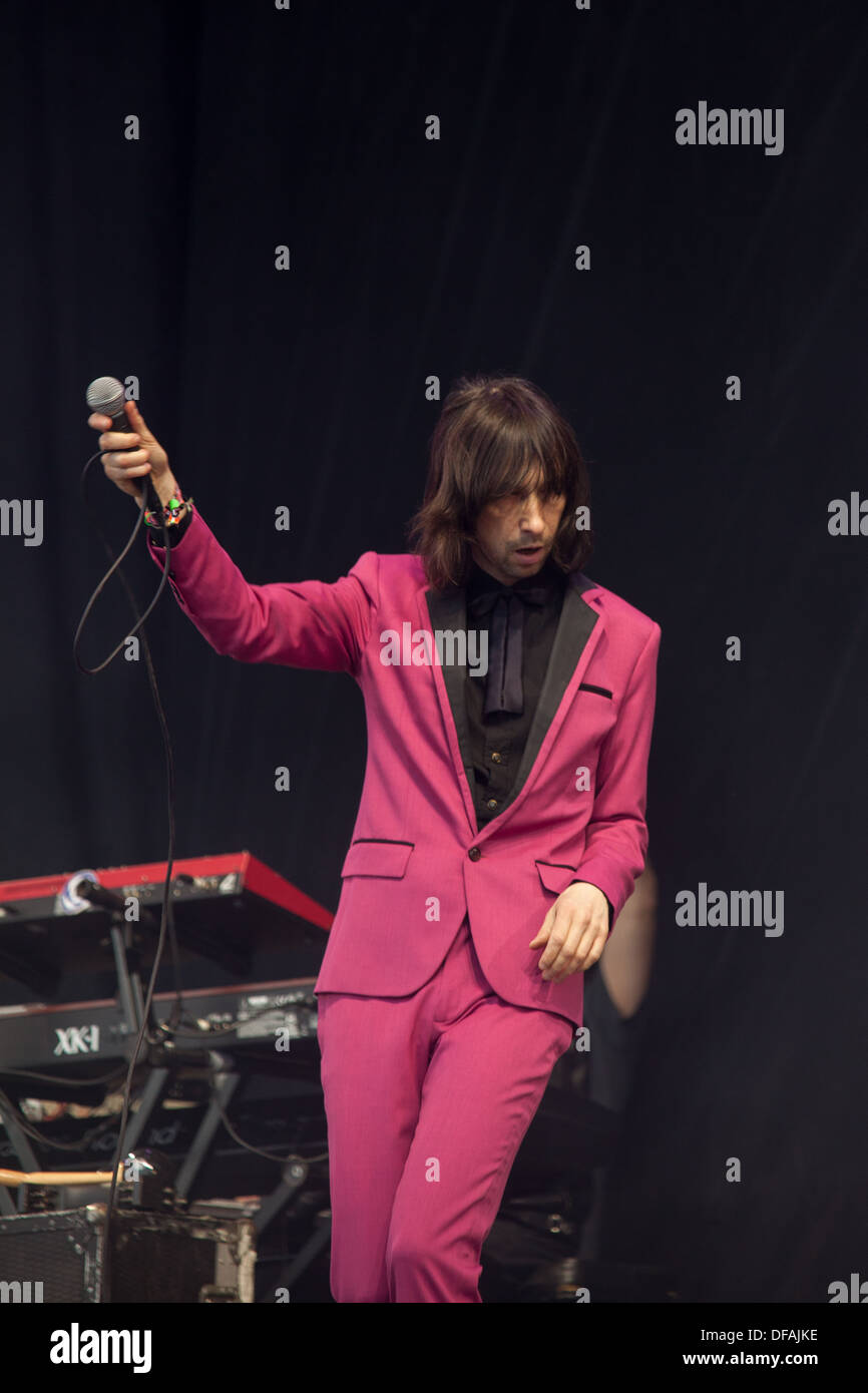 Bobby Gillespie and Primal Scream playing the Pyramid stage at the Glastonbury Festival 2013. - Stock Image